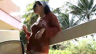 Brunette babe masturbating while smoking in the balcony