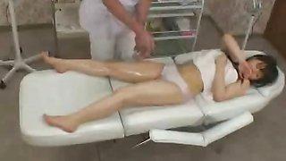 Innocent topless Japan teen has sensual oil massage
