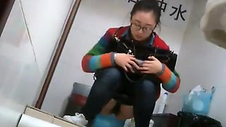 Nerdy chinese girl caught taking a leak