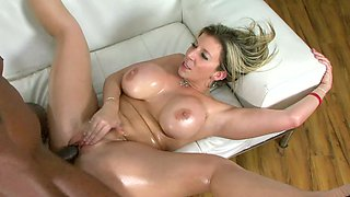 A busty harlot that loves black cock is getting a big black dick in her