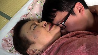 Curvy Asian granny has a nerdy boy licking her tight pussy
