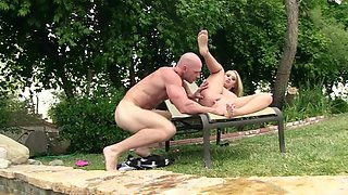 Stunning blonde gets screwed in the pool by muscular stud