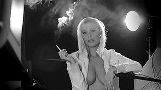 Smoking blonde riding a machine
