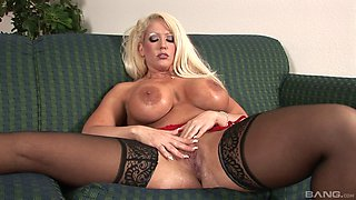 Fake-titted blonde Alura Jenson putting a toy deep in her cunt