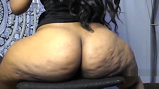 Curvy Indian Aunty dildo fucking her big asshole