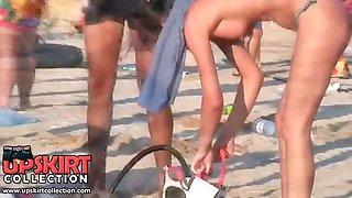 Pretty topless bikini girls are running on the beach