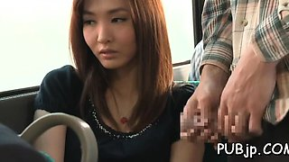 Giant bust on an asian babe getting manhandled in a bus