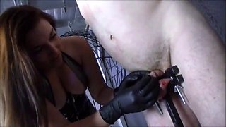 Domme Inflicts Crown Of Thorns On Impisoned Cock Of Naked male slave