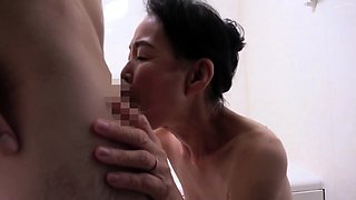Horny Asian granny with big boobs is a sucker for young meat