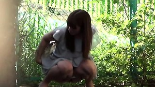 Asian babes spied peeing
