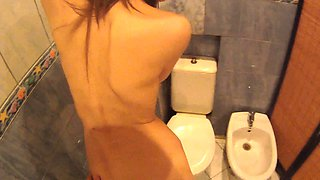 Skinny young slut pays for a drink with her juicy slit in the toilet