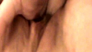 Amateur milf with big boobs takes a fist in her shaved pussy