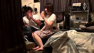 Busty Japanese housewife gets used by two guys on the bed