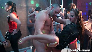 Feisty beauties gets freaky in the club for some giant cock blazing fuck