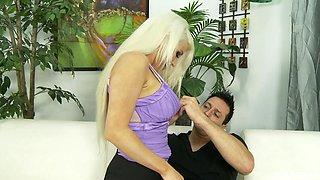 Amazing blonde Nikki Phoenix sucking a curved upwards cock