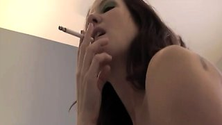 Annabelle Flowers is lying on her bed naked, smoking a