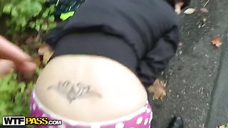 Brunette in funny panties blows cock outdoors