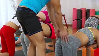Two Fit Brunette Babes Fucking Coach In The Gym
