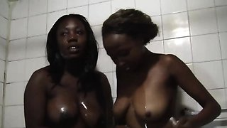 Two tempting African lesbians with amazing bodies having