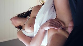 A sexy thing with natural tits is giving a blow job on the sofa
