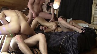 Young orgy girls all piled into bed and getting fucked