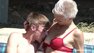 Still looking hot grey haired mature lady in red bikini gives BJ
